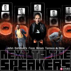 next to the speakers